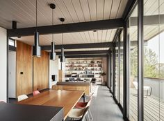 Tagged: Living Room, Pendant Lighting, Shelves, Sofa, Chair, Rug Floor, Wood Burning Fireplace, Standard Layout Fireplace, Floor Lighting, and Table. Photo 9 of 14 in See the Careful Transformation of a Midcentury Eichler in San Francisco