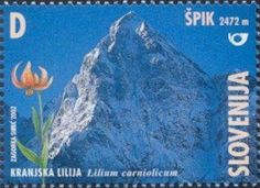 Stamp%3A%20Carniolan%20lily%20(Lilium%20carniolicum)%20in%20front%20of%20%C5%A0pik%20(Slovenia)%20(Mountains)%20Mi%3ASI%20393%2CYt%3ASI%20362%20%23colnect%20%23collection%20%23stamps