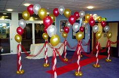 make a balloon arch by tying helium balloons to a string. Birthday Decoration Items, Safari Decorations, Balloon Decorations Party, Ceremony Decorations, Graduation Decorations, Graduation Ideas, Animated Christmas Decorations, Outside Christmas Decorations, Balloon Columns