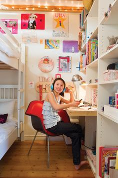Kid room with built in desk and bookshelves My kids have at least a little more floor space than this!