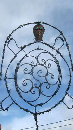 Barbed Wire Tribal Turtle Trellis With Glass Eyes Garden Art. $57.00, via Etsy.
