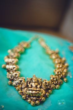 Handmade antique nagas jewellery representing the superior craftsmanship of its kind, available at GRT, Joyalukkas, and VBJ Chennai, Minchu studio photography www.shopzters.com
