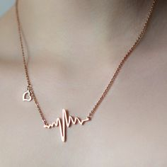 "A perfect gift for medical professionals! Fastens with a lobster clasp 18K rose gold on 316L surgical steel Pendant measure: 1.38"" x 0.8""/ 3.5 cm x 2 cm Chain length: 19""/48 cm This Heartbeat Cardiogram Necklace would make a perfect gift for any medical professional in your life. Be it your favorite nurse, your child in medical school or as a symbolic gift for your partner, this classy necklace is sure to put a smile on anyone's face."