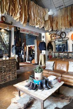 muy campestre las botas y las alfombras de pieles de animales. David Menéndez.Love how there are oak tag patterns hanging from the ceiling!