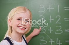 Blonde schoolgirl pointing at something Royalty Free Stock Photo