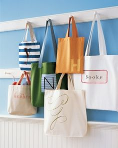 Shop with Reusable Bags Sturdier and more stylish than paper or plastic, fabric tote bags are great for carrying everything from groceries to gym clothes. Personalize yours with iron-on designs or pockets. @ marthastewart.com