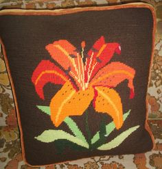 Tiger Lily needlepoint pillow. Boxed sides and back in rust velvet.