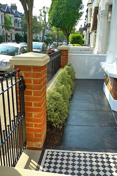 Railing & hedges - victorian front garden design london red rubber brick wall with yellow composite pier cap and mosaic tile path and paving House Front, Small Gardens, Small Front Gardens, Garden Wall, Front Patio, Garden Design London, Cottages Uk, Victorian Front Garden, Victorian Terrace