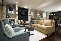 Living room by Candice Olsen- love the bench under the flatscreen tv