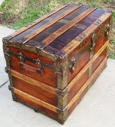 vintage steamer trunks I have this one , I need to refinish it !