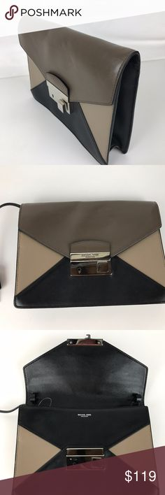 "Michael Kors Collection Leather Clutch Authentic. New, without Tags. Includes dust bag. Some marks on exterior from handling. See photos.   Includes Key for locking clasp. 9.25""L x 7"" H x 2"" D. 1 Zip and 1 slip interior pocket.  Thank you for your interest!  PLEASE - NO TRADES / NO LOW BALL OFFERS / NO OFFERS IN COMMENTS - USE THE OFFER LINK :-) Michael Kors Collection Bags Clutches & Wristlets"