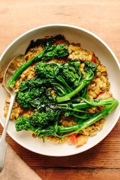 Recipe: Tomato-Braised Lentils with Broccoli Rabe — Recipes from The Kitchn. This was really yummy. The bitterness of the rabe balances nicely with the tomatoes. The lentils make it super hearty. Lentil Recipes, Veggie Recipes, Vegetarian Recipes, Dinner Recipes, Cooking Recipes, Healthy Recipes, Healthy Dinners, Beans Recipes, Salad Recipes