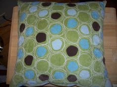 """Square knife edge pillow in """"Rainbow Reef"""" fabric (SIS Covers)."""