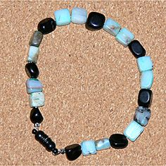 @Overstock.com - Susen Foster Onyx and Opal A Girls Best Friend Bracelet - This bracelet features semi-cubes of blue Peruvian opals along with onyx nuggets. This bracelets black magnet closure makes it easy on and off.  http://www.overstock.com/Main-Street-Revolution/Susen-Foster-Onyx-and-Opal-A-Girls-Best-Friend-Bracelet/6328598/product.html?CID=214117 $29.99