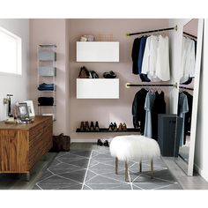 Shop corner hanging bar.   Sleek black/gold aluminum bar transforms the corner of any room into an impromptu closet.  A smart solution for small spaces, bar hangs modern in the entry, guest bedroom or bathroom.  Mounts easy with included hardware.