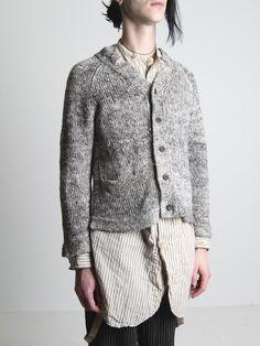 grey cardigan, raglan sleeves, pockets, buttons.