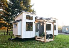 Tiny House Town a home blog sharing beautiful tiny homes and houses, usually under 500 square feet.  Really like the porch on this one. Usually see a lot of raised deck porches that can be intimidating for people with disabilities but this one seems like something my mother could manage.