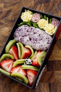 """gardenbento"" - That day I did not have much on hand, but I still tried to make my husband's lunch look pretty with egg and ham blossoms, a sushi rice onigiri mixed with shiso furikake, and fresh fruit.  Bento by Katherine (USA, Las Vegas)"