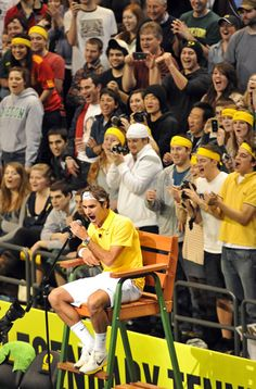 Roger Federer cheers on John McEnroe from the referees chair during the Clash of Champions at Matthew Knight Arena on March 8, 2011 in Eugene, Oregon.
