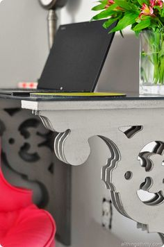 Cute inexpensive way to customize a desk. Buy two corbels and attach them to the wall, then add a piece of glass to the top!