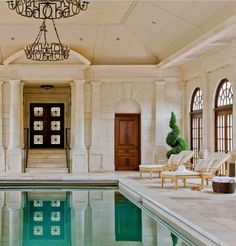 Very casual limestone indoor pool pavilion attached to a 1929 brick Georgian revival in the Boston suburbs [[gape]].