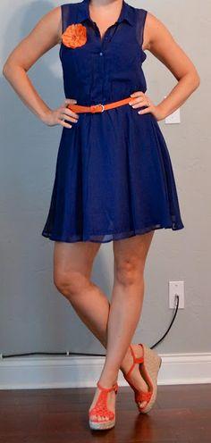 blue dress, orange belt, orange flower pin