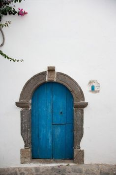 A doorway as blue as the sea on Panarea