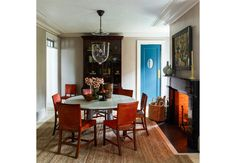 Stephen Gambrel-Dining Room with Antique Leather Chairs & Wood Cabinet, Blue Porthole Door