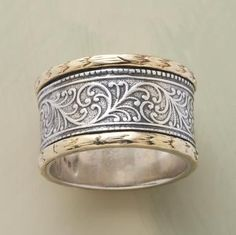 "Nestled between 14kt gold castings, etched vines are a sterling expression of nature's harmony. Handmade. Exclusive. Whole sizes 5 to 9. 1/2""W"