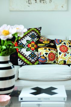 Black & White.  Assorted throw pillows pops of color.  Living room.