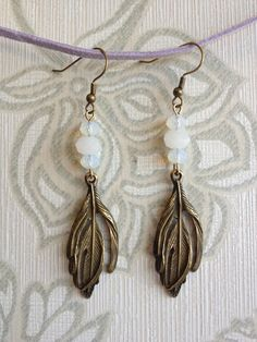 gold feather earrings with white jade and moonstone beads