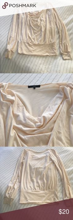 """Draped Neck Long Sleeve Top Long sleeve top with a draped cowl neck by Tart. Very gently worn and in excellent condition except for a small snag on the lower back (see photos). 23.5"""" long. Offers and questions welcome. Tart Tops"""
