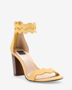 Our latest heels rise to any occasion thanks to the feminine scalloped straps and yellow hue. Contrasting chunky heel is versatile enough to step out with our skinny jeans or a lace dress. WHBM | Obsessories