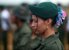 A fighter from Revolutionary Armed Forces of Colombia (FARC) stands in line during the opening of ceremony congress at the camp where they prepare for ratifying a peace deal with the government, near El Diamante in Yari Plains, Colombia, on September 17, 2016.