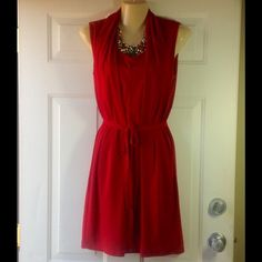 "SALE CRIMSON SLEEVELESS DRESS WITH BELT Beautiful, classy and comfortable boutique dress! Right above the knee length. Gathered style front and semi-fitted back. Fully lined. Side pockets. 95% polyester and 5% spandex. NO TRADES AND NO MODELING. REASONABLE OFFERS MADE USING THE ""OFFER"" ICON ARE WELCOMED AND CONSIDERED. Joy Joy Dresses Midi"