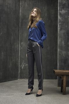 Blue silky shirt with grey pin-striped pants.