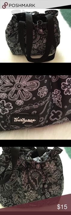 👩‍🍳Thirty One Lunch Tote - Like New🖤💫 🖤👩‍🍳Like New Thirty One Lunch Tote with a beautiful black and white flower pattern. This lunch tote is fully insulated and has an elastic easy entry top to keep you lunch perfect!  It's 14 inches wide, 8.5 inches height and 5 inches in depth. Included are designer napkins to coordinate with your lunch.   This gorgeous Thirty One 🖤lunch bag will motivate you to pack a healthy lunch every night for your next work day!  No more takeout or fast…