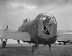"The wrecked rear turret of Avro Lancaster B Mark I, ED413 'DX-M' ""Minnie the Moocher"", of No. 57 Squadron RAF at Scampton, Lincolnshire, after returning from a night raid to Oberhausen, Germany, on the night of 14/15 June 1943, during which it was attacked by German night fighters. A cannon shell exploded in the rear turret, killing the gunner, Sergeant R F Haynes of Nuneaton Cheshire, while further strikes smashed the radio and navigational equipment, and riddled the fuselage of the…"