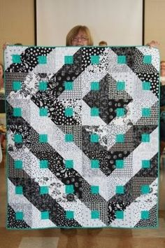 Love the aqua!  This is my one exception for biding with a light color.  Stunning! paradigm shift quilt | Black, White and Turquoise. Paradigm shift quilt | Turquoise