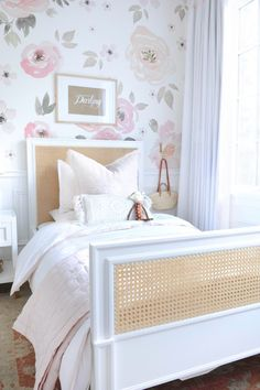 soft floral wallpaper in girl bedroom, rattan kid bed in girl bedroom design with pink and white girl room decor, teen girl room decor, tween girl bedroom design Childrens Bedroom Wallpaper, Wallpaper For Girls Bedroom, Little Girl Wallpaper, White Girls Rooms, White Bedrooms, Little Girl Beds, Big Girl Bedrooms, Girl Toddler Bedroom, Shared Bedrooms