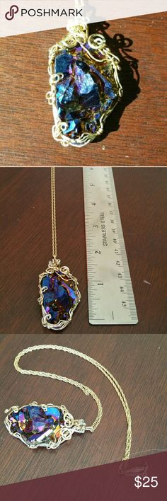 """Wire wrap purple aurora stone necklace Adeptly wire-wrapped purple stone with 20"""" chain necklace. The chain and wire are gold colored, but I do not believe they are gold. The stone is clearly color treated, both front and back (see all photos) to provide that pretty multi-hued appearance. This is one of those necklaces that seems magical. Jewelry Necklaces"""