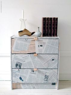 newspaper :) It would be adorable with bright color knobs!