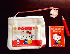 My 1976 hello kitty coin purse with memo and pencil