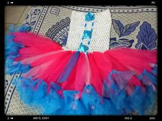 Lalaloopsy Inspired Tutu Dress. Made of Fuchsia & Blue Soft tulle & an Ivory Stretchable crochet with Blue satin Rosette embellishments.