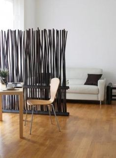 Dark bamboo room divider; partial wall screen - would be a good solution to a floating tv in an awkward floor plan