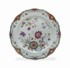 A Chinese export famille rose charger with shaped rim, 18th century. enameled in the pseudo 'Tobacco Leaf' pattern  12½in. (31.8cm.) diameter #christies