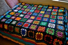 """Colorful granny square afghan. and m.y Mom spent HOURS making """"granny squares"""" and then putting them together to make a afgan!"""