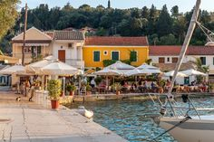 A seafront tavern in Lakka, Paxos. Paxos Greece, Corfu, Paxos Island, Places To Travel, Places To Visit, Luxury Villa Rentals, Travel And Leisure, Greece Travel, Greek Islands