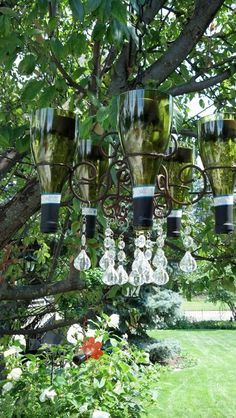 Wine bottle chandelier with solar lights inside. Will look great this summer in the yard. Wine Bottle Chandelier, Solar Chandelier, Outdoor Chandelier, Bottle Lights, Chandelier Ideas, Empty Wine Bottles, Wine Bottle Art, Diy Bottle, Wine Bottle Crafts