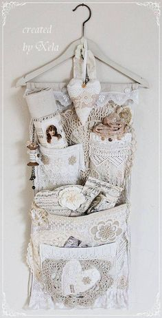 What a beautiful way to organize small pockets. Pieces of lace/crochet for storage